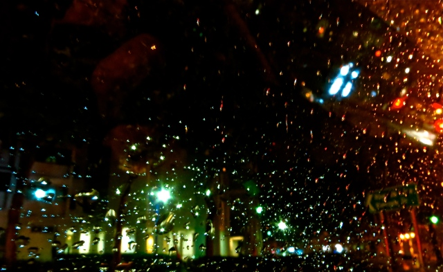 rainy lights on car window